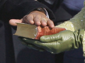 Barack Obama taking oath; Michelle Obama holding Lincoln bible..